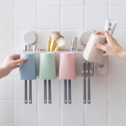 A Rack On Which Electric Toothbrush Cups Are Placed On A